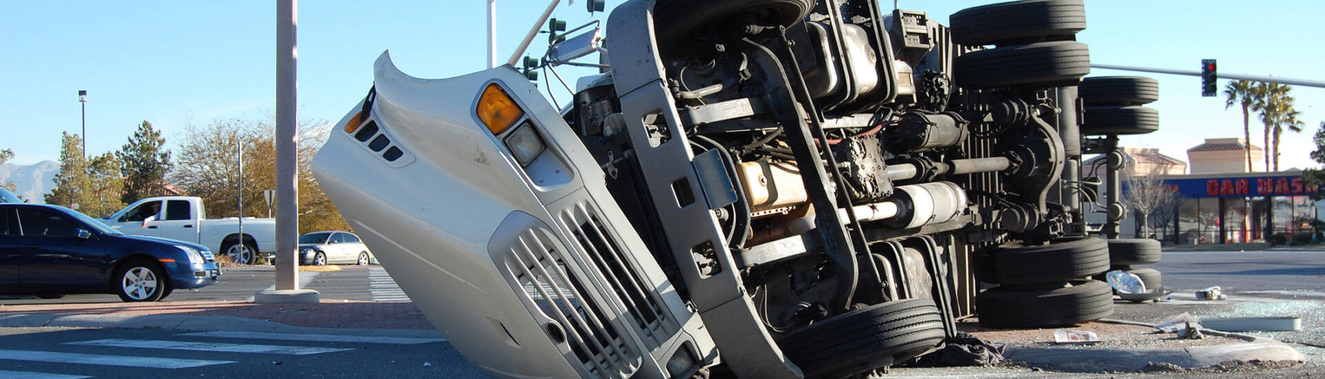 Overturned tractor trailer at a busy intersection