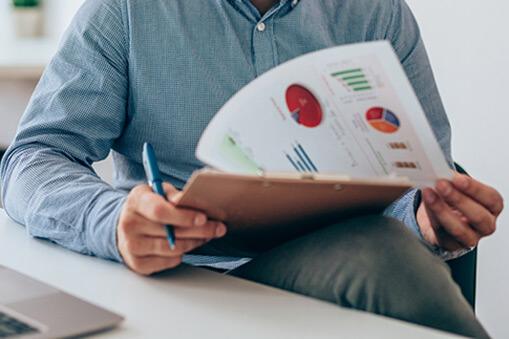 Businessperson reviews a report